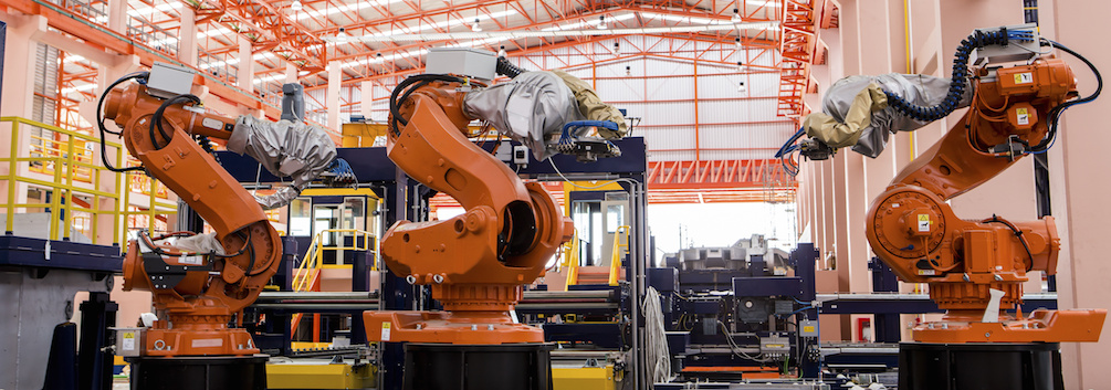 Robots welding in a production line
